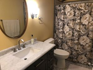 Bathroom Remodeling in Williamsburg, VA. Full Bathroom remodeled; new drywall finished and painted, new wiring, lighting, vanity and vanity top, tiling and sink plumbing. (1)
