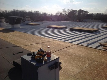 New roof at tidemill shopping center in Hampton va
