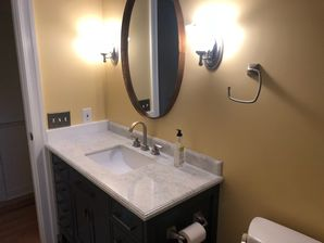 Bathroom Remodeling in Williamsburg, VA. Full Bathroom remodeled; new drywall finished and painted, new wiring, lighting, vanity and vanity top, tiling and sink plumbing. (3)