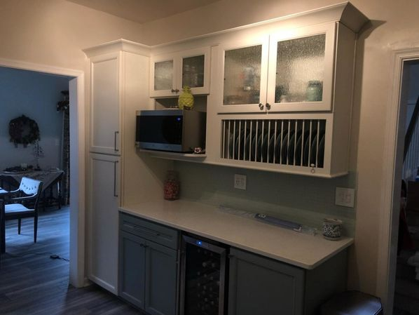 Kitchen Remodeling in Williamsburg, VA. New Cabinets with custom rain glass inserts, new quartz countertops. mosaic tile backsplash, new wiring and lighting, painting and trim and new laminate flooring. (3)