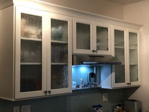 Kitchen Remodeling in Williamsburg, VA. New Cabinets with custom rain glass inserts, new quartz countertops. mosaic tile backsplash, new wiring and lighting, painting and trim and new laminate flooring. (1)